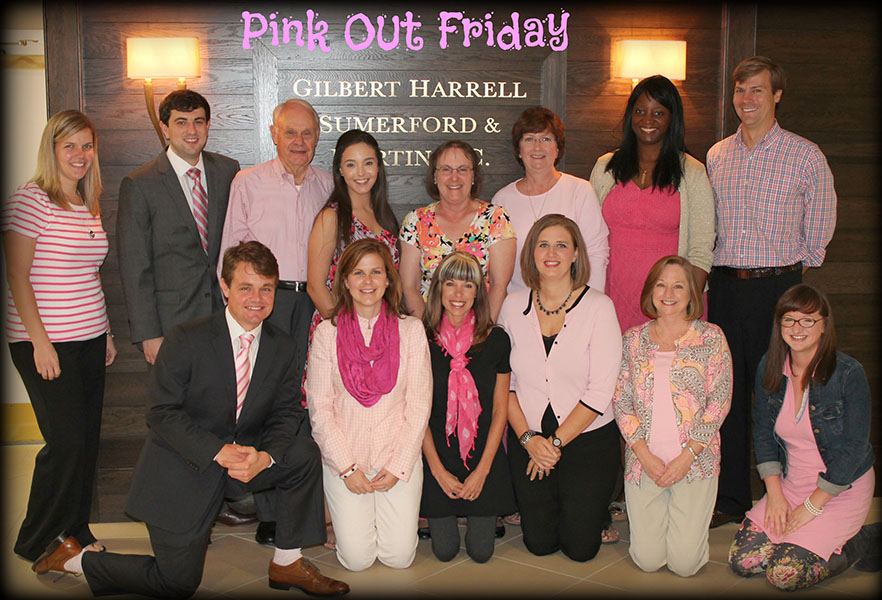 """A group photo with the caption """"Pink Out Friday"""""""
